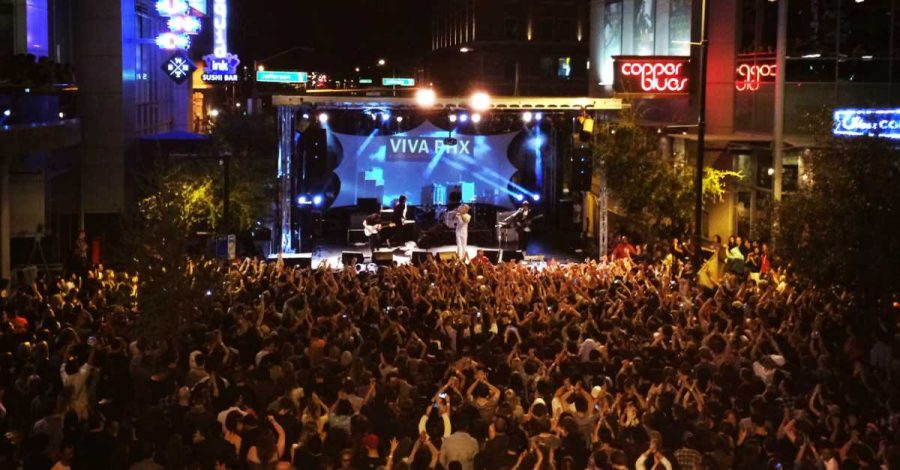 The day becomes night as concert goers enjoy a performance at Viva PHX 2015