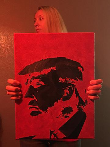Sophomore Borwick displays a painting of President Donald J. Trump.