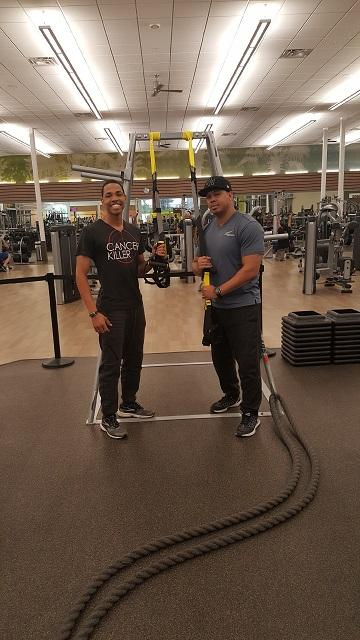 trainers Eric Custudio(left) and V. Fuller(right) pose near a power tower LA Fitness Glendale, AZ Aug.8 2017