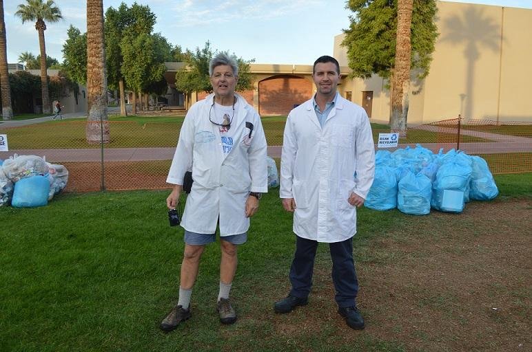 Dr. Robert Reavis and Dr. David Lang of the Biology department standing near the separated recyclables Nov. 15(Glendale)