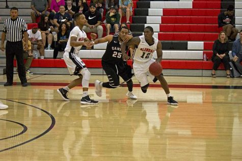 Kited Johnson works to drive past a GCU defender. Photo By: Nick Spooner