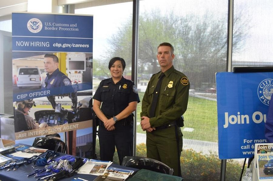 Officer Balcaba of the U.S. Customs and Border Protection and Agent Barnhill of the U.S. Border Patrol offered information for students interested in law enforcement.  Mar 21 (Glendale)