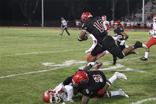 Running back Jaion Colbert hurdling over Mesa defender and wide receiver Brian Smith on Saturday Sept. 1 at GCC.
