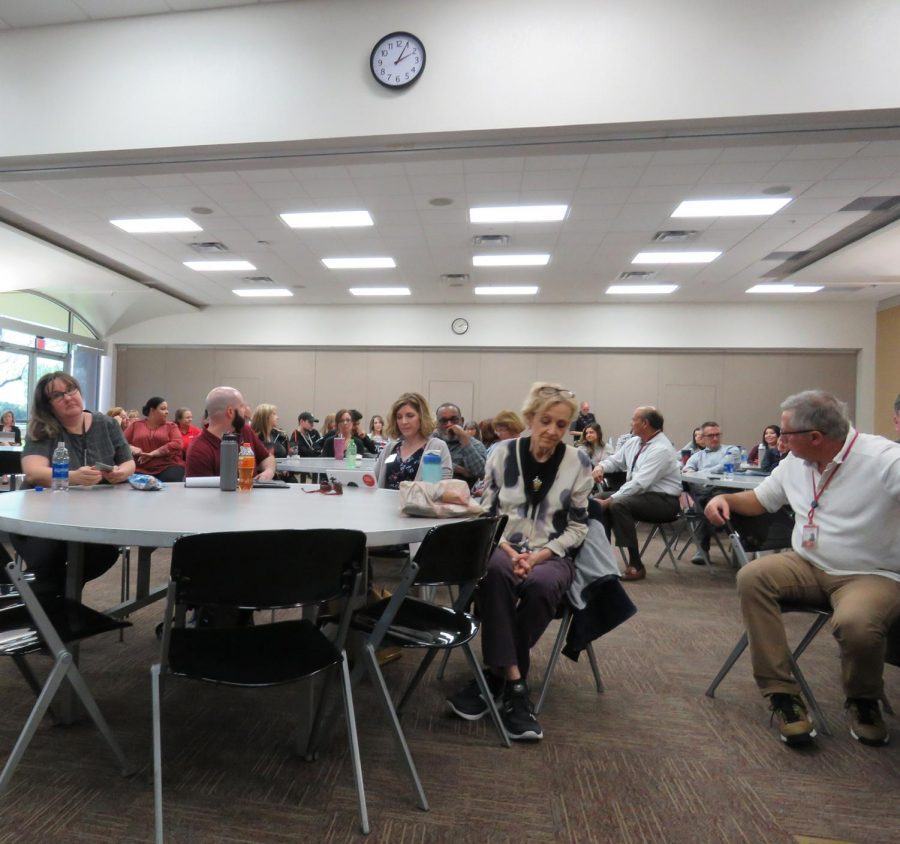 Faculty and staff listen during Interim Chancellor Dr. Steven Gonzales listening tour discussion Feb. 24 in Glendale, Ariz.